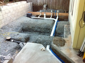 Plumber has roughed in prior to slab being poured.